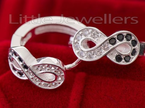 A black & white silver infinity loop earring.