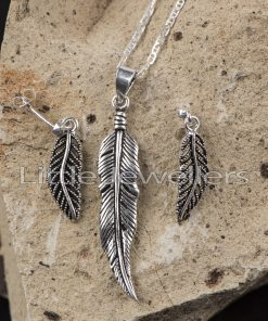 Finely detailed elegant leaf pendant with matching earrings