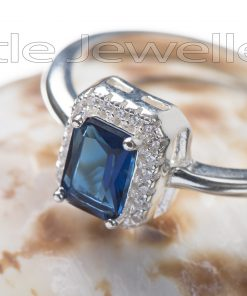 A magical silver blue ring deserves to sparkle on some lucky lady's finger!
