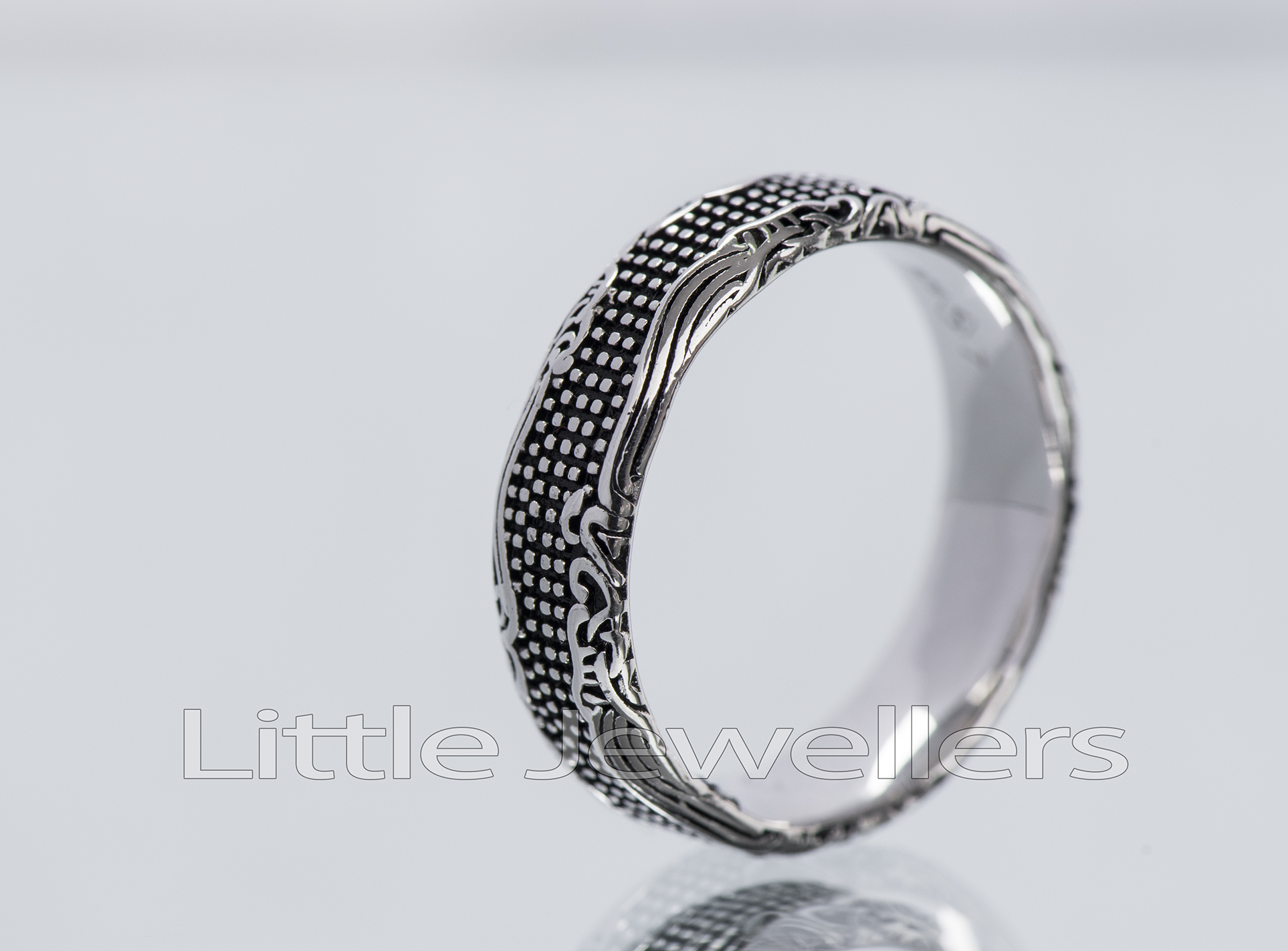A unique oxidized silver ring is a nice addition to your every day outfit.