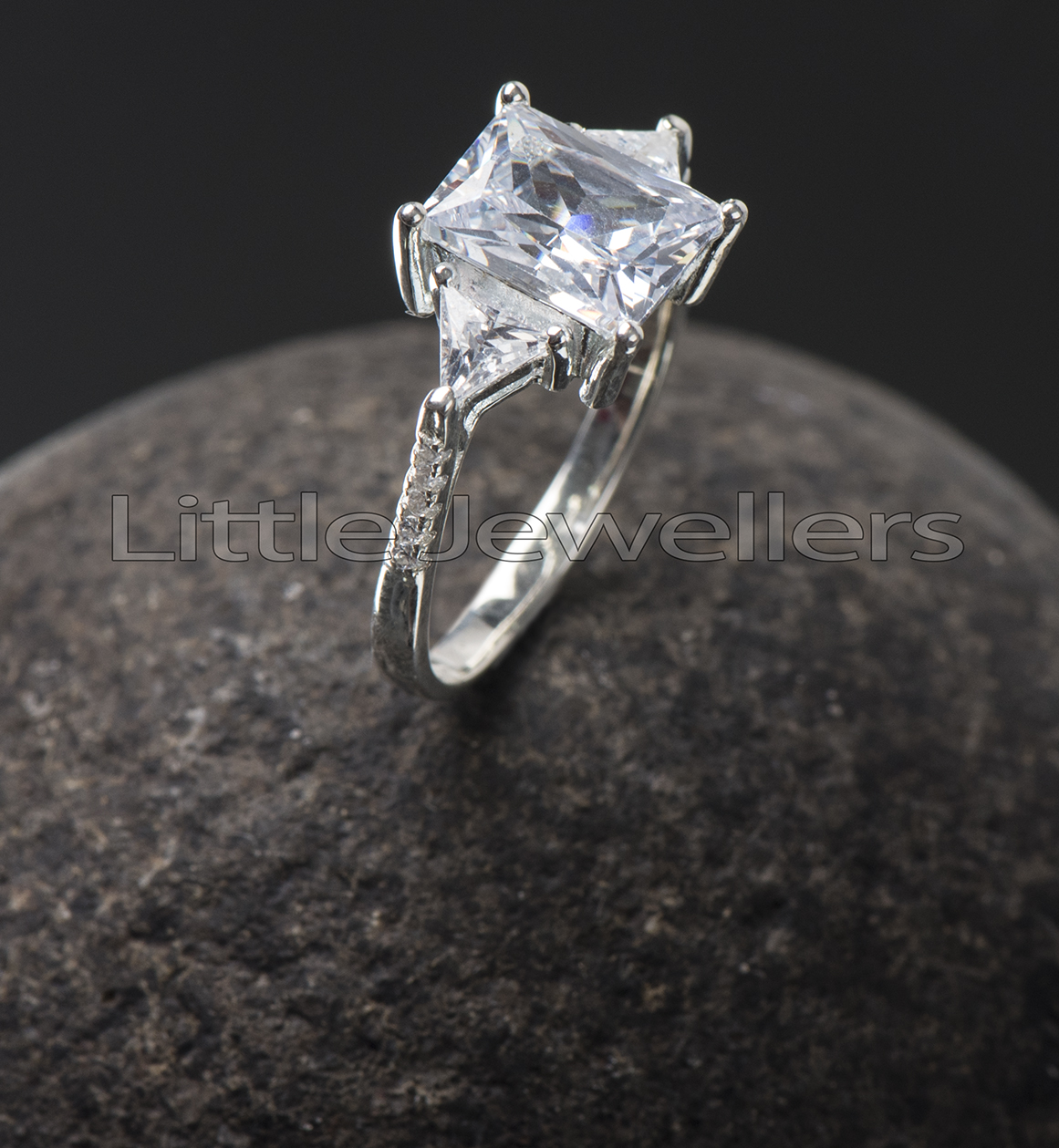 A delicate and sparkly silver engagement ring