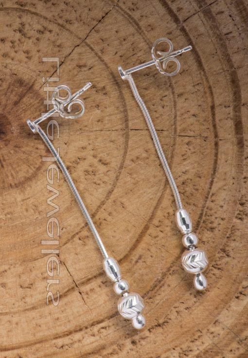 A precious pair of silver dangle earrings