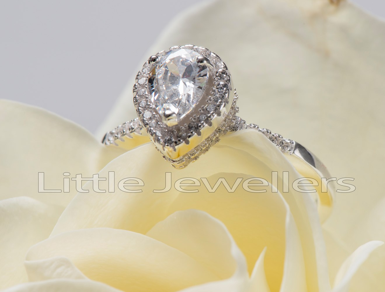 pear shaped silver engagement ring