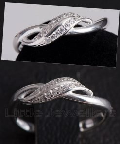 A dainty twisted infinity design promise ring.