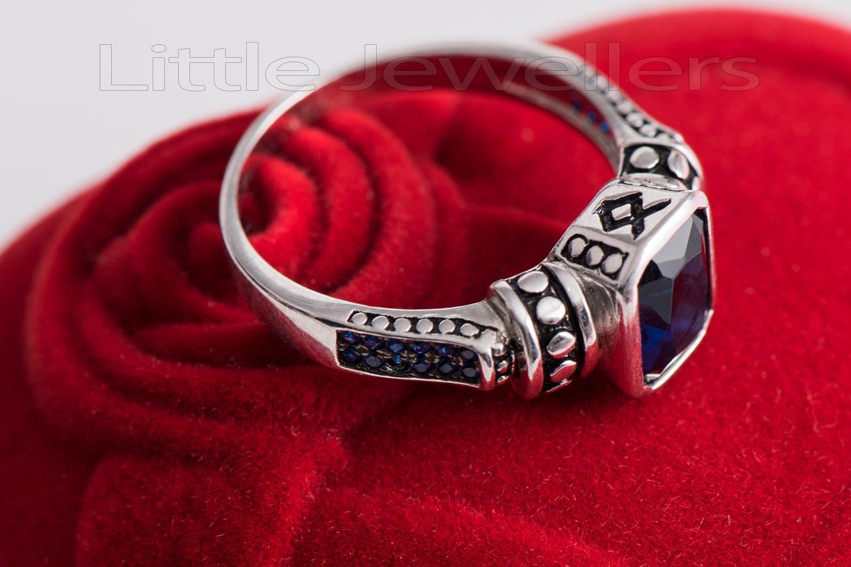 A vintage cz blue sapphire engagement ring