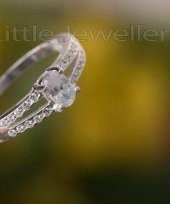 A brilliant split shank engagement ring