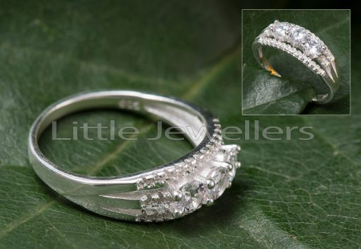A Delicate Three Stone Sterling Silver Engagement Ring