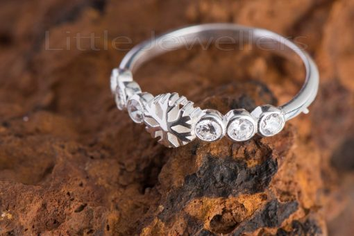 An adorable and feminine snow flake promise ring