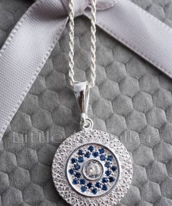 A simple and elegant circle of life necklace that's embellished with white & blue stones