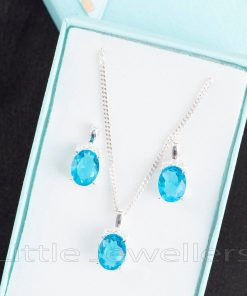 This oceanic blue necklace & earring set is the perfect combination of styles, modern and classic