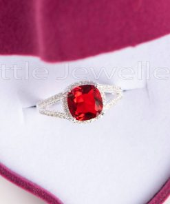 This magnificent vibrant red engagement ring is a true definition of love
