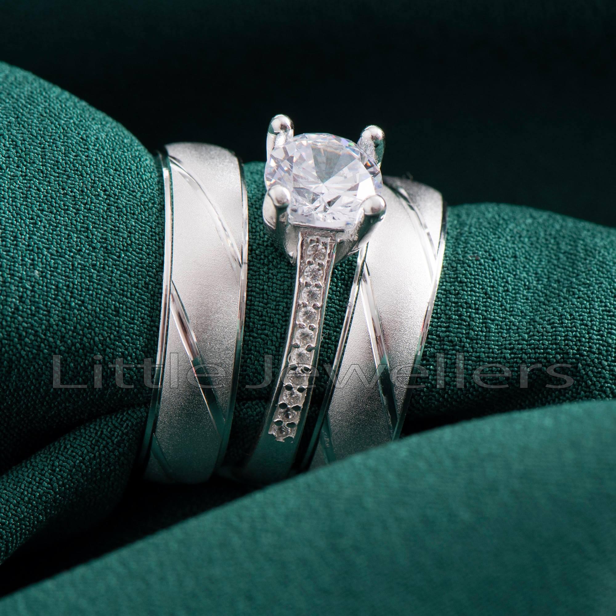 A stunning sterling silver matching wedding band set