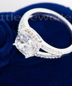 This stunning halo design engagement ring is a symbol of love & commitment to marry
