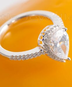 This radiant pear shaped Engagement ring is luxurious & romantic