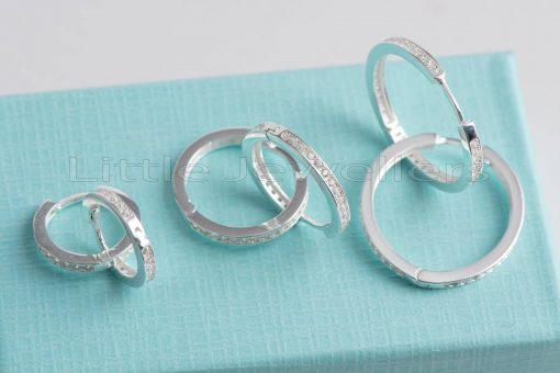 An adorable pair of sterling silver hoop earrings