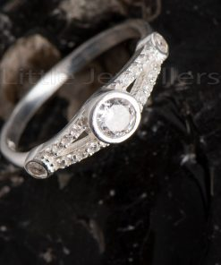 A delicate three stone promise ring that is a true reflection of you immense love.