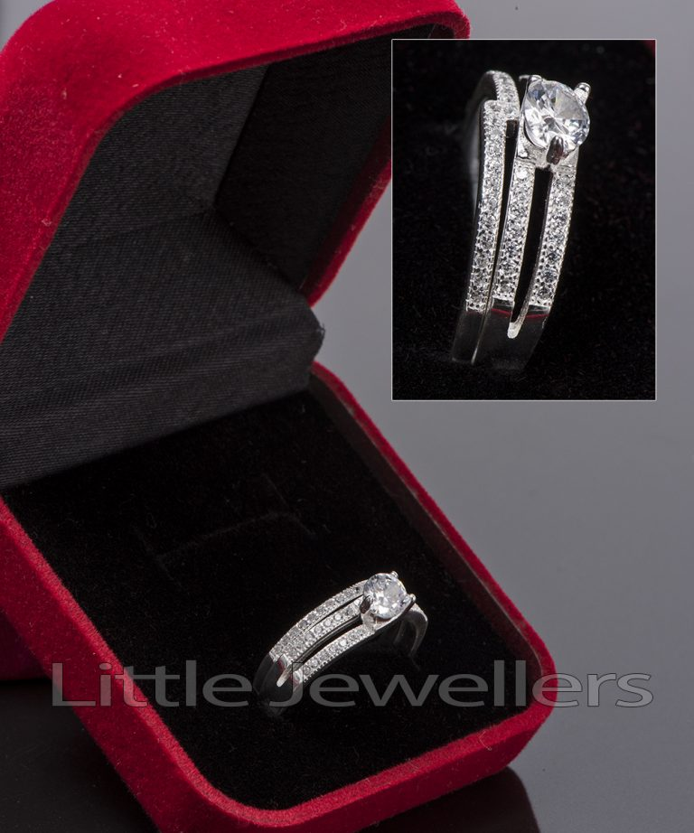 A perfectly petite sparkling silver double engagement ring